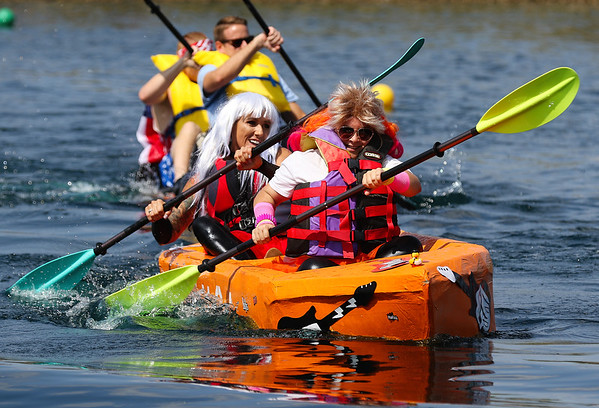 JAY YOUNG | THE GOSHEN NEWS<br /> Ashley Kramer, front, and Charmagne Lafortune, with the YWCA, pull ahead of the competition during the United Way's Great Cardboard Boat Race Friday afternoon at the LaSalle Bristol Pond in Elkhart.