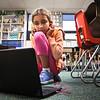 LEANDRA BEABOUT | THE GOSHEN NEWS<br /> Second-grader Sophia KhattriChettri listens to an audiobook on one of Middlebury Elementary School's new Chromebooks.