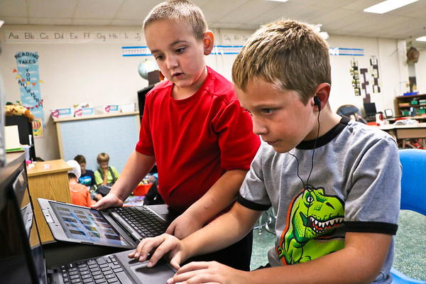 LEANDRA BEABOUT | THE GOSHEN NEWS<br /> Drew Pontius and Griffin Miller, both second-graders at Middlebury Elementary School, work together to find their favorite audiobook on the school's new Chromebooks.
