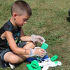 SHERRY VAN ARSDALL | THE GOSHEN NEWS<br /> Five-year-old Mason Panelli, of Milford, puts green dye on his T-shirt during the 50th celebration of Elkhart County Parks at Ox Bow County Park in Dunlap Sunday afternoon.