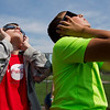 JAY YOUNG | THE GOSHEN NEWS<br /> Bethany Christian eighth-grade students Joel Garber, left, and Josiah Schlabach, watch Monday's solar eclipse from bleachers behind the school.