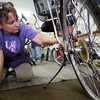 JAY YOUNG | THE GOSHEN NEWS<br /> Volunteer Jennifer Granzow, of Goshen, cleans a recumbent bike Wednesday morning at Chain Reaction Bicycle Project, 510 East Washington Street.