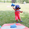 SHERRY VAN ARSDALL | THE GOSHEN NEWS<br /> Two-year-old Leonardo Garcia, of Elkahrt, throws a bean bag into the hole of a bean bag toss game during the 50th celebration of Elkhart County Parks at Ox Bow County Park in Dunlap Sunday afternoon.