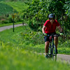 JAY YOUNG | THE GOSHEN NEWS<br /> A cyclist makes his way east along the Pumpkinvine Trail near mile marker three Friday morning.
