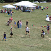 SHERRY VAN ARSDALL | THE GOSHEN NEWS<br /> Visitors try keeping their balance on wooden stilts during the 50th celebration of Elkhart County Parks at Ox Bow County Park in Dunlap Sunday afternoon.