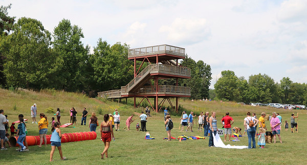SHERRY VAN ARSDALL | THE GOSHEN NEWS<br /> Visitors played with the lawn games during the 50th celebration of Elkhart County Parks at Ox Bow County Park in Dunlap Sunday afternoon.