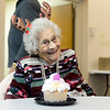 "BEN MIKESELL | THE GOSHEN NEWS<br /> Dorothy Landon of Bristol, right, celebrates her 100th birthday donning a pair of reindeer antlers Thursday at the Salvation Army. When a family member asked where her red nose was, Landon replied, ""Rudolph has it."""