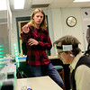 BEN MIKESELL | THE GOSHEN NEWS<br /> Alex Steiner, junior at Goshen College, explains how the mind-controlled robot works as mathematics professor David Housman tests it out Monday at Goshen College's 2017 Electronics & Robotics Show. The headband around Housman's head measures concentration and sends signals for the robot to move along the floor.