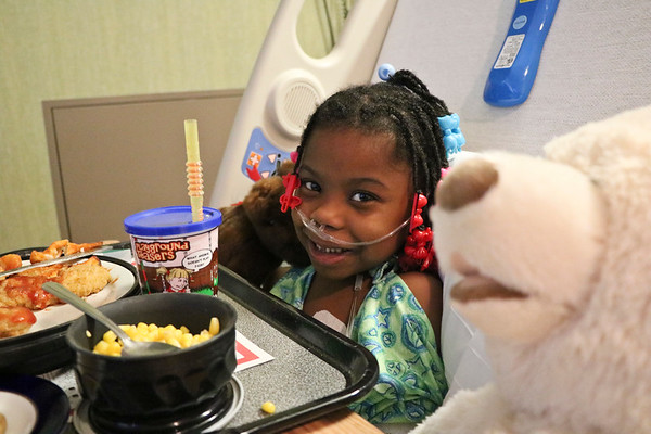 LEANDRA BEABOUT | THE GOSHEN NEWS<br /> Five-year-old Jalaunie Birdsong had a smile on her face as the staff from South Bend International Airport said farewell, leaving two teddy bears behind. Birdsong said she plans to call both bears 'Lucy.'