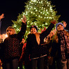 BEN MIKESELL | THE GOSHEN NEWS<br /> Fourth and fifth-graders from Taylor Herndon's music class at Wakarusa Elementary School sing 'Deck the Halls' during Christmas Around the Tree on Monday in Wakarusa. The group of students, Younger Generation, perform every year in front of the Christmas tree in the middle of downtown.