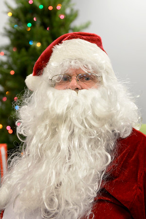 BEN MIKESELL | THE GOSHEN NEWS<br /> Joe Tusing of Elkhart is new to the Santa suit. He spent the Dec. 18 evening at the Elkhart Public Library greeting children.