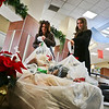 LEANDRA BEABOUT | THE GOSHEN NEWS<br /> Director of marketing and development Julie Curtis, left, and marketing intern Alyssa Atkinson helped unload hundreds of teddy bears Tuesday morning at Elkhart General Hospital.