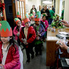 BEN MIKESELL | THE GOSHEN NEWS<br /> West Goshen kindergarteners from Katrina Godzisz's class walk through the halls at Greencroft Goshen, handing out gift bags to residents. The students made their gift bags with the money provided by Mayor Jeremy Stutsman's Year of Goodness initiative.