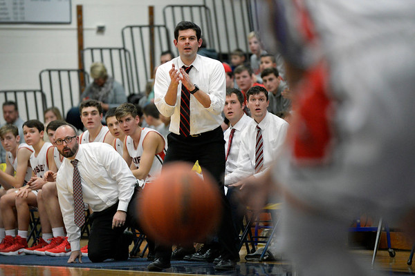 BEN MIKESELL | THE GOSHEN NEWS<br /> Goshen head coach Michael Wohlford instructs his team from the bench during Thursday's game against East Noble in the 2017 Fairfield Holdiay Tournament.