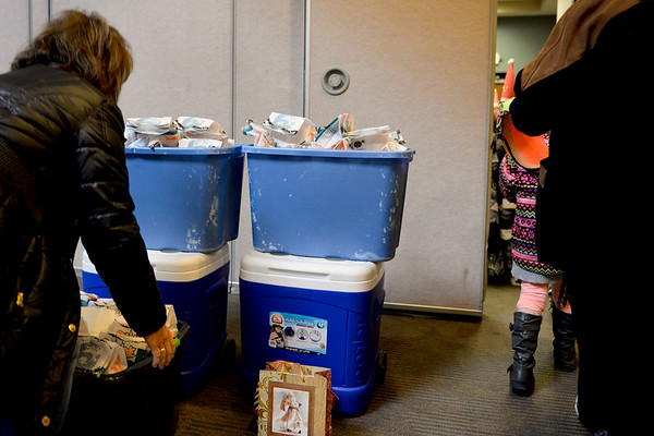 BEN MIKESELL | THE GOSHEN NEWS<br /> Students' lunches are stacked outside a conference room Wednesday at Greencroft Goshen. After caroling through the community, students returned to the main building to eat their lunches.