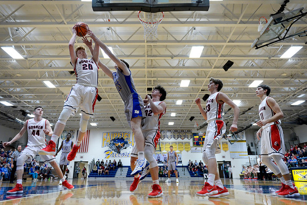 BEN MIKESELL | THE GOSHEN NEWS<br /> Goshen senior Brockton Yoder pulls in a rebound during Thursday's game against East Noble in the 2017 Fairfield Holiday Tournament.