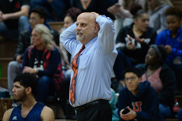 BEN MIKESELL | THE GOSHEN NEWS<br /> Elkhart Central head coach Terry Smith looks on in disbelief after a charge was called during Thursday's game against Fairfield in the 2017 Fairfield Holiday Tournament.