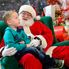 BEN MIKESELL | THE GOSHEN NEWS<br /> Braxton Sissom, 5, of Elkhart, tells Santa what we wants for Christmas on Dec. 12 at Concord Mall.