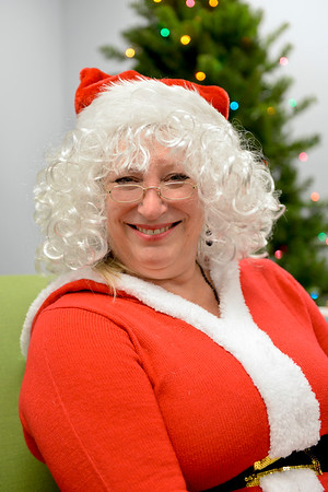 BEN MIKESELL | THE GOSHEN NEWS<br /> Tina Ervin of Milford has been dressing as Mrs. Claus for three years. She visits the Elkhart Public Library in costume, where she used to work.