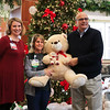 LEANDRA BEABOUT | THE GOSHEN NEWS<br /> On behalf of Elkhart General Hospital, nurses Lindsay Latkowski and Michaela Nufer accept hundreds of teddy bears from Mike Daigle, executive director of South Bend International Airport.