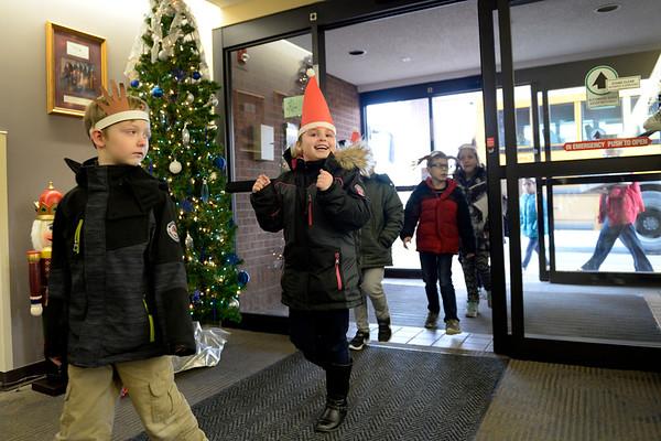 BEN MIKESELL | THE GOSHEN NEWS<br /> West Goshen Elementary students walk into Greencroft Goshen on Wednesday.