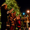 BEN MIKESELL | THE GOSHEN NEWS<br /> Ashlyn Hammond, 8th grader at NorthWood Middle School, reads a verse from the story of Christmas in the Bible with a group from Wakarusa Mehtodist Church during Christmas Around the Tree on Monday in Wakarusa.