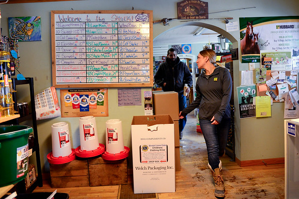 BEN MIKESELL | THE GOSHEN NEWS<br /> Jessica Watson guides customer Elliot Moore of Goshen through her store, Jack's Feed Shack, Thursday in Bristol.