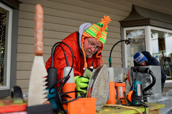 BEN MIKESELL | THE GOSHEN NEWS<br /> Stan Horne of Churubusco places an iron on his tool rack after smoothing out a piece of his ice sculpture Thursday outside of Davis Mercantile in Shipshewana. For this year's festival, the 10-year veteran is making an ice sleigh that people can sit in, which will weigh close to 2,200 pounds.
