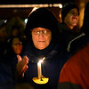 BEN MIKESELL | THE GOSHEN NEWS<br /> Mary Gilbert of Goshen keeps her candle lit during a vigil for the proposed detention center Saturday outside the Elkhart County Courthouse in Goshen.