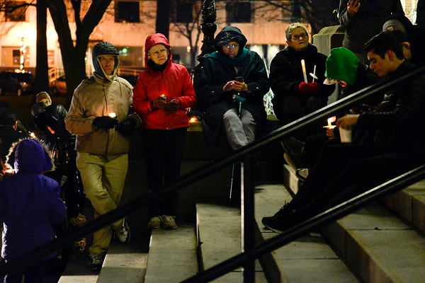 BEN MIKESELL | THE GOSHEN NEWS<br /> Attendees of the candle light vigil for the proposed immigration detention center listen to speakers Saturday outside the Elkhart County Courthouse.