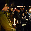 BEN MIKESELL | THE GOSHEN NEWS<br /> People light their candles in support of opposition to the proposed immigration detention center in Elkhart County on Saturday outside the Elkhart County Courthouse in Goshen.