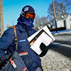 BEN MIKESELL | THE GOSHEN NEWS<br /> United States Postal Service mailman Brent Buckley delivers letters in near zero weather Wednesday along his route on N. Main Street in Goshen. In 10 years with USPS, Buckley learned wearing ski goggles and a scarf are essential when working in the cold. Temperatures are expected to rise through the rest of the week, but another cold front will blast Elkhart County this weekend, according to the National Weather Service.