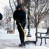 "BEN MIKESELL | THE GOSHEN NEWS<br /> Scott Woldruff of Goshen shovels snow outside his business, Woldruff's Footwear & Apparel, early Thursday morning in downtown Goshen. Thursday's snowfall was the first of the winter. ""I'm ready for winter,"" Woldruff said. ""I like the festivities that come with it."""