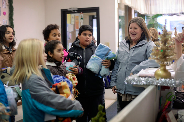 BEN MIKESELL | THE GOSHEN NEWS<br /> Erin Haseley, assistant principal at Chamberlain Elementary School, smiles as students bring blankets into The Window. Haseley helped the Chamberlain students make 75 fleece blankets as part of Mayor Jeremy Stutsman's Year of Goodness initiative.