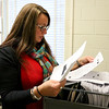 BEN MIKESELL | THE GOSHEN NEWS<br /> Beth Jungels sifts through a file cabinet full of letters addressed to Santa Claus on Friday at the Syracuse Post Office. As the elf in charge for the Operation Santa program in Indiana, Jungels has already received more than 150 letters from across the country intended for Santa that people can adopt to fulfill the sender's wish anonymously.