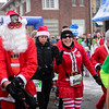 BEN MIKESELL | THE GOSHEN NEWS<br /> Runners particpate in the Santa Run on Saturday in Elkhart. Participants were given the option to enter the 10K, 5K or one-mile walk, sponsored by The Michiana Pay it Forward Foundation.