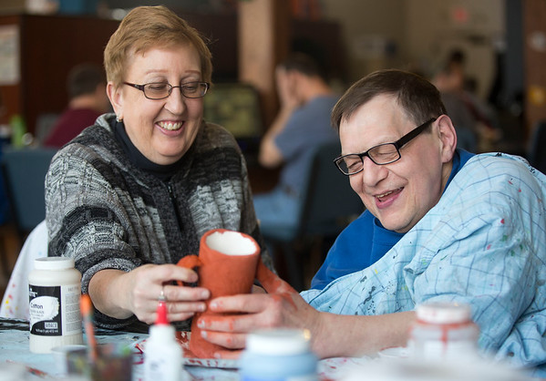 JAY YOUNG | THE GOSHEN NEWS<br /> Anne Cripe helps Joe Lehman paintaa mug on Thursday morning at Gaining Grounds.