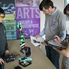 JOHN KLINE | THE GOSHEN NEWS<br /> Northridge High School sophomore Jackson Kenyon, left, gets his initial project evaluation by volunteer judges John Buschert, center, and Annie Steiner, right, prior to the Robot Arm competition at Saturday's Science Olympiad Regional Tournament.