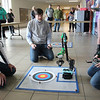 JOHN KLINE | THE GOSHEN NEWS<br /> Volunteer judge John Buschert, a physics professor at Goshen College, center, observes as Northridge High School sophomore Jackson Kenyon, right, participates in the Robot Arm competition during the 2017 Science Olympiad Regional Tournament at Goshen College Saturday afternoon.