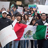 JAY YOUNG | THE GOSHEN NEWS<br /> Protesters march near Goshen High School on Thursday afternoon. They were protesting President Donald Trump's immigration policies.