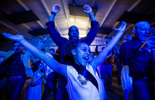 JAY YOUNG | THE GOSHEN NEWS<br /> A blue light fills the room as seven-year-old Brooklyn Scott and her father Anthony, both of Merrillville, do the YMCA during the Daddy Daughter Valentine's Dance hosted by Goshen Parks and Recreation on Thursday evening at the Elkhart County fairgrounds.
