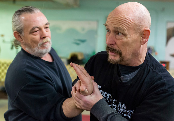 JAY YOUNG | THE GOSHEN NEWS<br /> Bruce Andresen, right, uses Army veteran Steve Pace to demonstrate a Hapkido move during a martial arts training session on Feb. 9, 2017 in Elkhart.