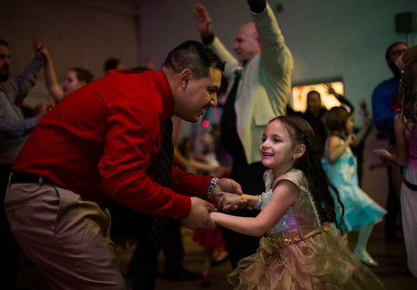 JAY YOUNG | THE GOSHEN NEWS<br /> Luis Morales finds a spot on the crowded dance floor to dance with his six-year-old daughter Nataly, both of Goshen, during the Daddy Daughter Valentine's Dance hosted by Goshen Parks and Recreation on Thursday evening at the Elkhart County fairgrounds.