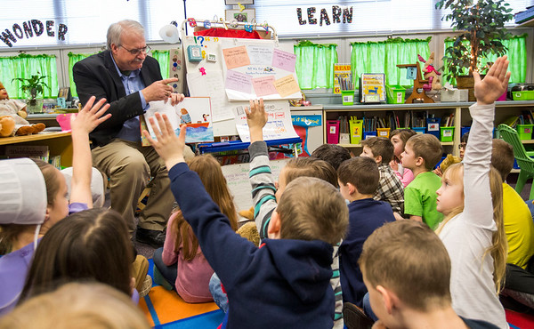 JAY YOUNG | THE GOSHEN NEW<br /> Pastor Ron Diener reads a book about teddy bears to the first grade class at Nappanee Elementary School on Thursday morning.