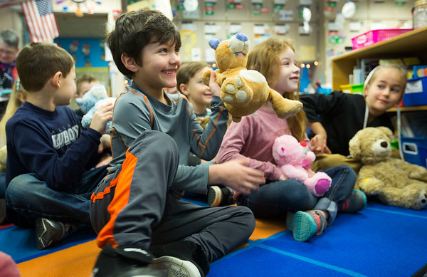 JAY YOUNG | THE GOSHEN NEW<br /> Jamie Truex smiles big as he shows off his teddy bear that giggles to his first-grade class at Nappanee Elementary School on Thursday morning.