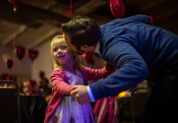 JAY YOUNG | THE GOSHEN NEWS<br /> Josh Hren gives his five-year-old daughter Catherine a kiss on the cheek during the Daddy Daughter Valentine's Dance hosted by Goshen Parks and Recreation on Thursday evening at the Elkhart County fairgrounds.