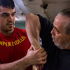 JAY YOUNG | THE GOSHEN NEWS<br /> Marine veteran Mitchell Sanderson twists the arm of Army veteran Steve Pace while practicing Hapkido moves during a martial arts training session on Feb. 9, 2017 in Elkhart.