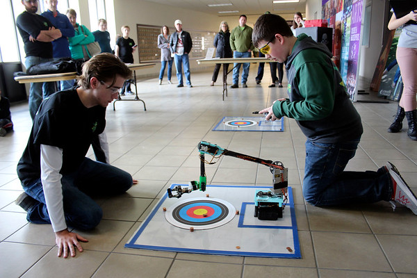 JOHN KLINE | THE GOSHEN NEWS<br /> Northridge High School sophomore Jackson Kenyon, right, participates in the Robot Arm competition during Saturday's Science Olympiad Regional Tournament at Goshen College.