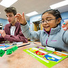 JAY YOUNG | THE GOSHEN NEWS<br /> West Goshen Elementary third-grade student Nancy Sanchez plays a reading comprehension game with Goshen High basketball player Eliot Nafziger after school on Monday afternoon. Players from the Goshen High boys basketball team visited West Goshen Elementary for an hour Monday after school and spent time reading, playing games and shooting hoops with students at the school.
