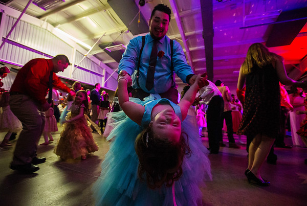 JAY YOUNG | THE GOSHEN NEWS<br /> Four-year-old Madelynn Aguilar closes her eyes while her father, Gabe, both of Goshen, dips her as they dance during the Daddy Daughter Valentine's Dance hosted by Goshen Parks and Recreation on Thursday evening at the Elkhart County fairgrounds.